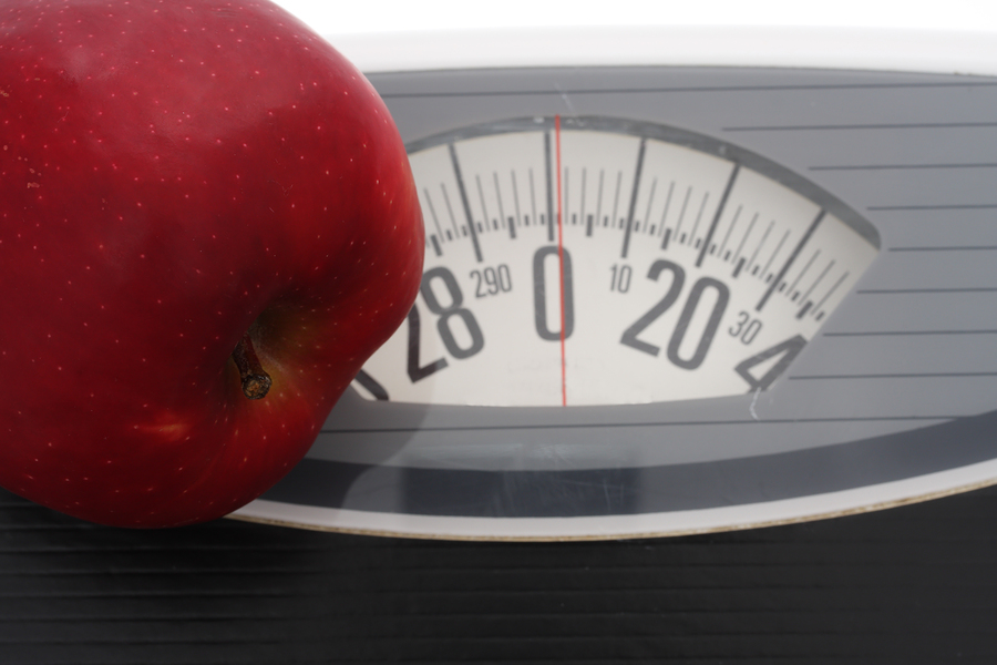 Close up of apple on scales - show healthy living